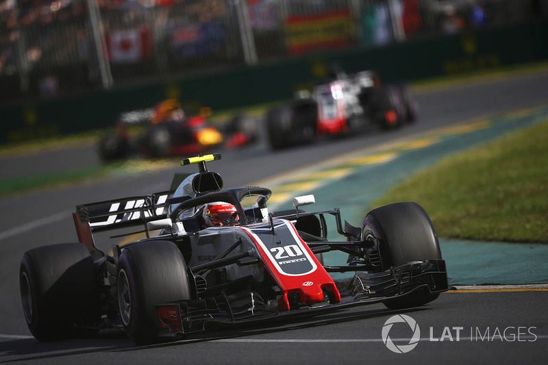 Kevin Magnussen, Haas F1 Team VF-18 Ferrari, leads Romain Grosjean, Haas F1 Team VF-18 Ferrari, and Daniel Ricciardo, Red Bull Racing RB14 Tag Heuer