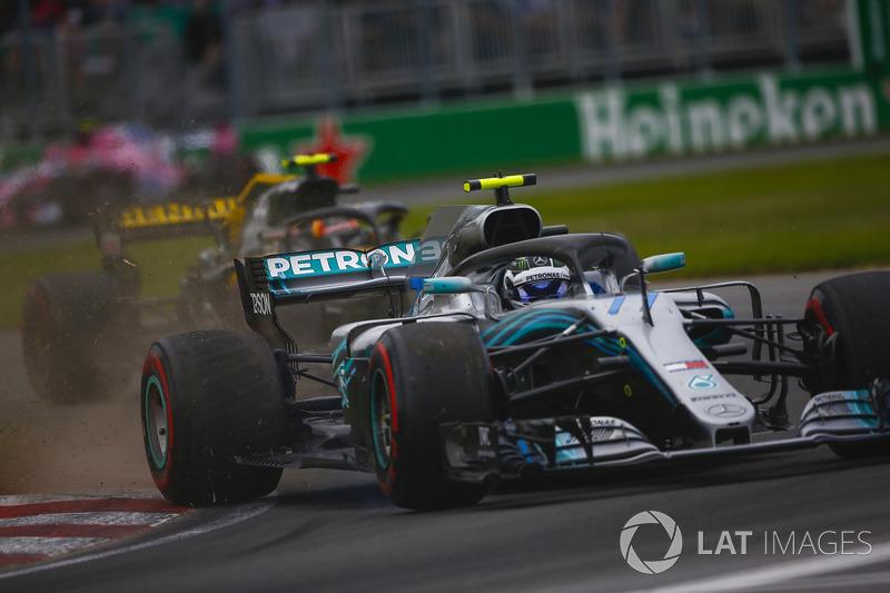 Valtteri Bottas, Mercedes AMG F1 W09, kicks up debris ahead of Max Verstappen, Red Bull Racing RB14