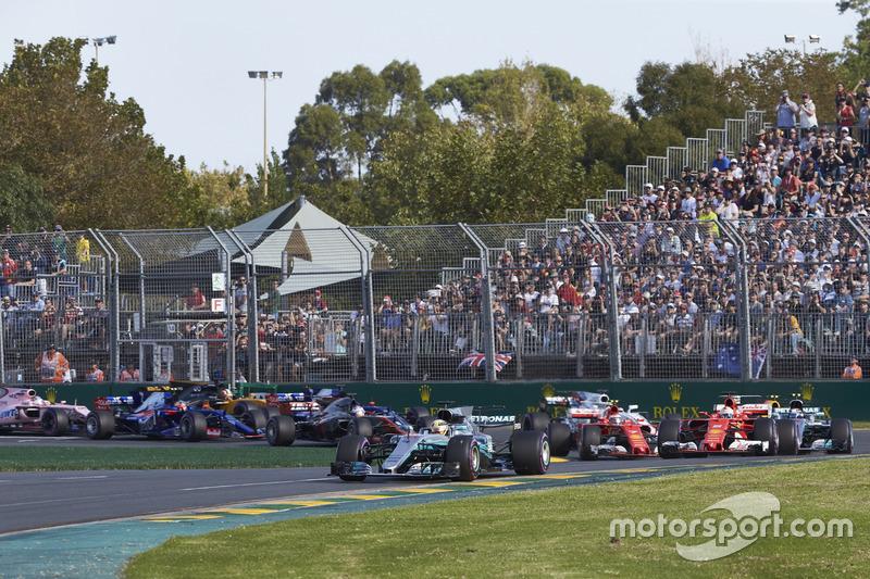Lewis Hamilton, Mercedes AMG F1 W08, leads Sebastian Vettel, Ferrari SF70H, Valtteri Bottas, Mercedes AMG F1 W08, Kimi Raikkonen, Ferrari SF70H, Max Verstappen, Red Bull Racing RB13, and the rest of the field at the start