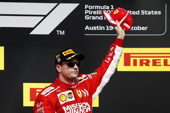 Kimi Raikkonen, Ferrari, celebrates on the podium after winning the race