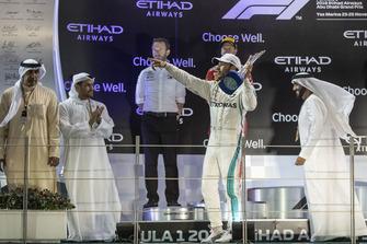 Lewis Hamilton, Mercedes AMG F1 celebrates on the podium with the trophy