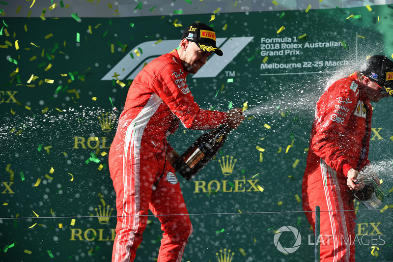 Race winner Sebastian Vettel, Ferrari and Kimi Raikkonen, Ferrari celebrate on the podium with the champagne