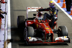 Mark Webber, Red Bull Racing, gets a lift back with Fernando Alonso, Ferrari F138