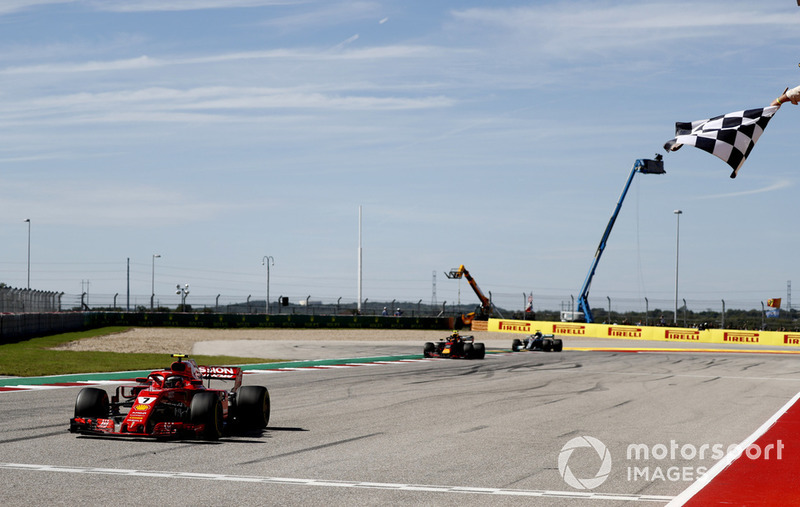 Kimi Raikkonen, Ferrari SF71H, 1st position, takes the chequered flag ahead of Max Verstappen, Red Bull Racing RB14, 2nd position, and Lewis Hamilton, Mercedes AMG F1 W09 EQ Power+, 3rd position