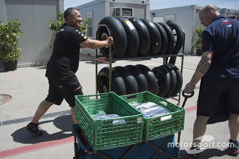 Team members with tires and equipment