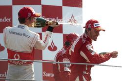 Podium: Jenson Button, McLaren MP4-25 Mercedes, 2nd position, Fernando Alonso, Ferrari F10, 1st posi