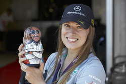 A Mercedes fan holds a Lewis Hamilton matryoshka figurine doll