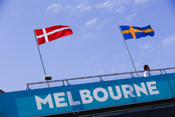 Danish and Swedish flags above a Melbourne sign