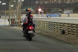 Race Retiree Daniel Ricciardo, Red Bull Racing gets a lift back to the pits on a motorbike