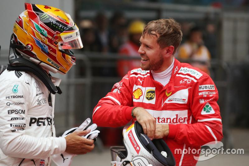 Sebastian Vettel, Ferrari, congratulates Lewis Hamilton, Mercedes AMG, in Parc Ferme