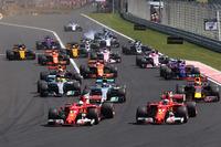 Sebastian Vettel, Ferrari SF70H, leads, Kimi Raikkonen, Ferrari SF70H at the start of the race