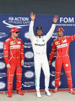 Kimi Raikkonen, Ferrari, Lewis Hamilton, Mercedes AMG F1 and Sebastian Vettel, Ferrari celebrate in parc ferme