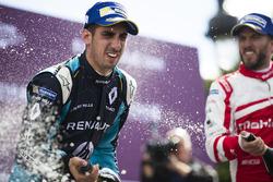 Sébastien Buemi, Renault e.Dams, and Nick Heidfeld, Mahindra Racing, celebrates on the podium