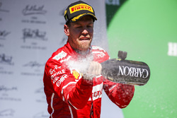 Race winner Sebastian Vettel, Ferrari, sprays Champagne from the podium