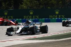 Lewis Hamilton, Mercedes AMG F1 W09, leads Valtteri Bottas, Mercedes AMG F1 W09, and Sebastian Vettel, Ferrari SF71H