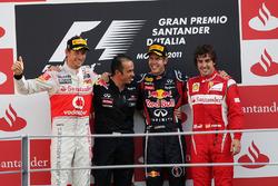 Podium: Jenson Button, McLaren, second, Stefano Sordo, Red Bull Racing Race Engineer, Sebastian Vettel, Red Bull Racing; race winner; Fernando Alonso, Ferrari, third