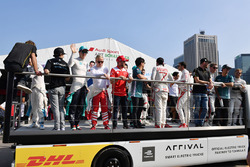 The drivers wave to the fans from the track parade truck