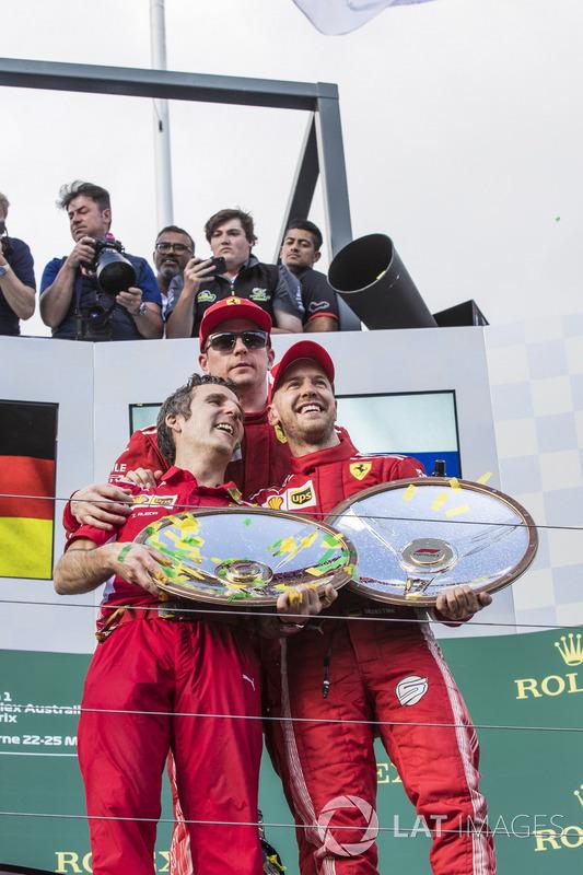 Inaki Rueda, Ferrari Race Strategist, Sebastian Vettel, Ferrari and Kimi Raikkonen, Ferrari celebrate on the podium with the trophies