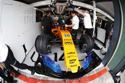 Fernando Alonso, McLaren, in the team's garage, surrounded by mechanics
