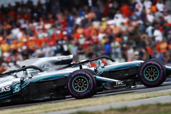 Lewis Hamilton, Mercedes AMG F1 W09, and Valtteri Bottas, Mercedes AMG F1 W09, wave in celebration of victory