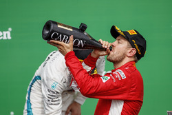 Sebastian Vettel, Ferrari, 1st position, drinks Champagne on the podium