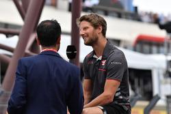 Romain Grosjean, Haas F1 is interviewed on the drivers parade