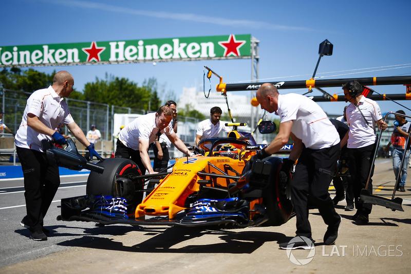 Stoffel Vandoorne, McLaren, is wheeled into his pit garage.