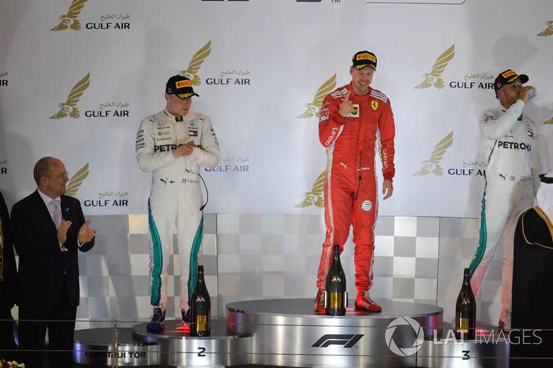 Sebastian Vettel, Ferrari, Valtteri Bottas, Mercedes-AMG F1 and Lewis Hamilton, Mercedes-AMG F1 celebrate on the podium