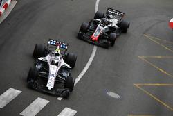 Sergey Sirotkin, Williams FW41, leads Romain Grosjean, Haas F1 Team VF-18