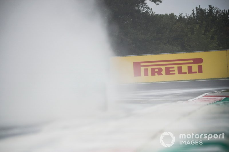 Cement dust which was laid down to cover a heavy oil spill in the F2 race prior to the session fills the air