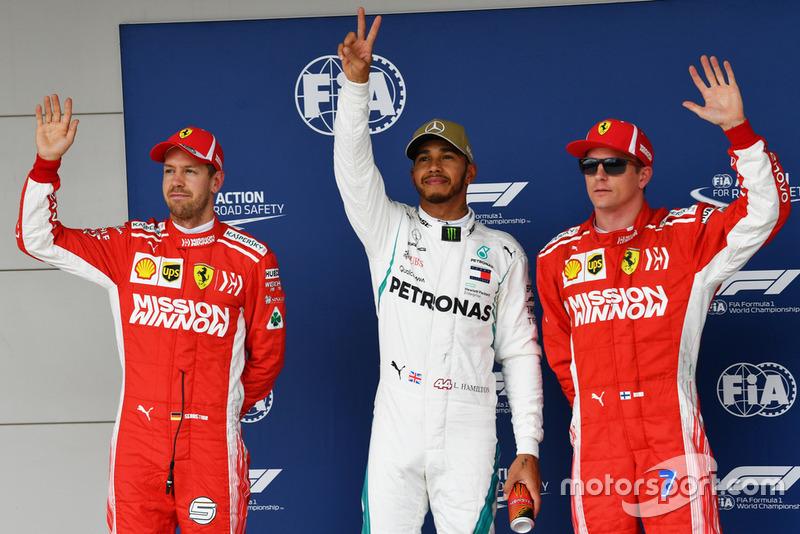 Il poleman Lewis Hamilton, Mercedes AMG F1, il secondo qualificato Sebastian Vettel, Ferrari, il terzo qualificato Kimi Raikkonen, Ferrari,
