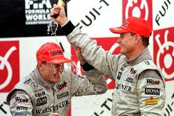 Podium:  David Coulthard and Mika Hakkinen celebrate