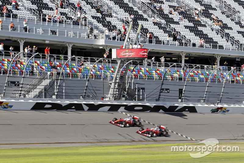 Sebastian Vettel, Ferrari F60 and Kimi Raikkonen, Ferrari F60