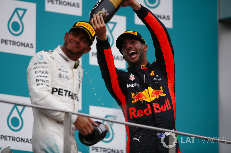 Podium: third place Daniel Ricciardo, Red Bull Racing, sprays champagne over second place Lewis Hamilton, Mercedes AMG F1