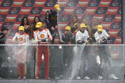 Podium: Race winners David Reynolds, Luke Youlden, Erebus Motorsport Holden with champagne