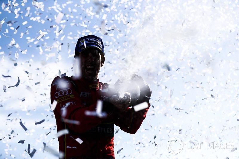 Lucas di Grassi, ABT Schaeffler Audi Sport, sprays the champane after winning the championship