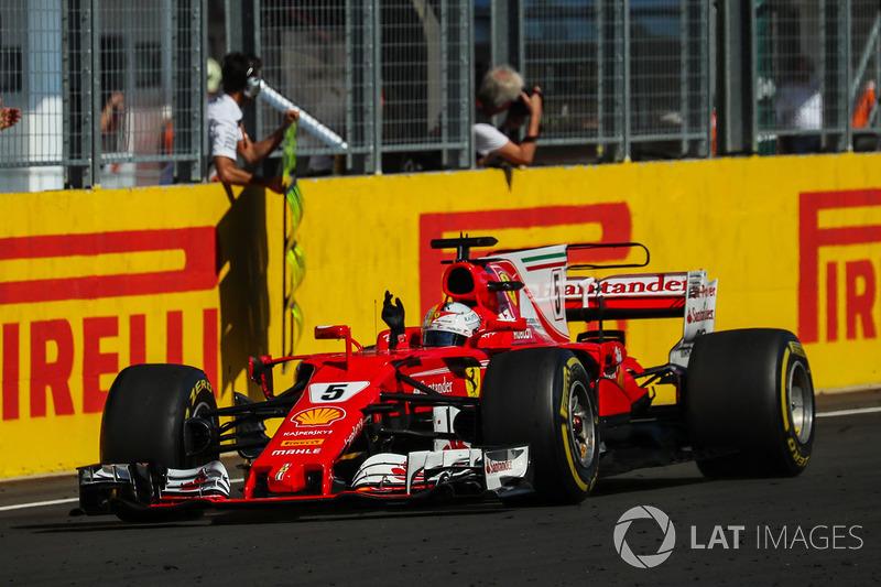 Race winner Sebastian Vettel, Ferrari SF70-H crosses the line
