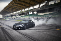 Lewis Hamilton, Mercedes AMG F1, performs a donut in a Mercedes AMG F1 GT S