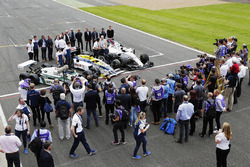 Sir Frank Williams and Patrick Head pose between a Williams FW40, FW11 Honda and FW08 with Antonio Pizzonia, Martin Brundle, Paul di Resta, Jason Plato, Felipe Massa, Williams, Lance Stroll, Williams, Riccardo Patrese, Nigel Mansell, Keke Rosberg, Damon H