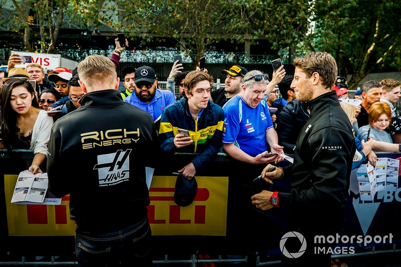 Kevin Magnussen, Haas F1 Team Romain Grosjean, Haas F1 Team sign autographs for fans at the Federation Square event