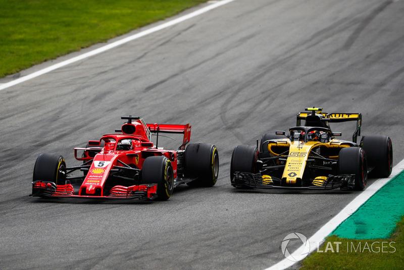 Sebastian Vettel, Ferrari SF71H, y Carlos Sainz Jr., Renault Sport F1 Team R.S. 18