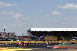 Sebastian Vettel, Ferrari SF71H leads on lap one as Lewis Hamilton, Mercedes-AMG F1 W09 spins