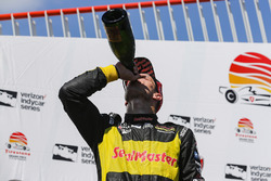 Sébastien Bourdais, Dale Coyne Racing with Vasser-Sullivan Honda celebrates with champagne on the po