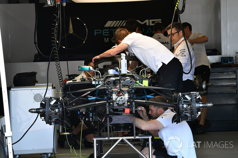 Mercedes-AMG F1 W09 EQ Power+ is worked on in the garage
