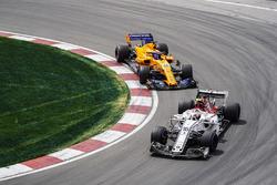 Charles Leclerc, Sauber C37, leads Fernando Alonso, McLaren MCL33