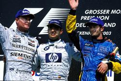 Podium: 1st Juan Pablo Montoya, BMW Williams, centre. 2nd David Coulthard, McLaren Mercedes, left. 3rd Jarno Trulli, Renault, right