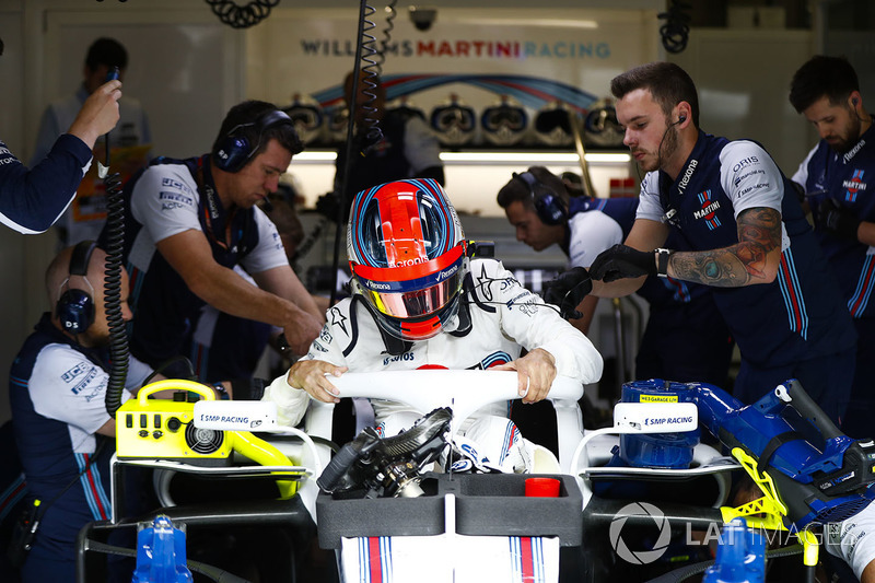 Robert Kubica, Williams FW41, climbs out of his car