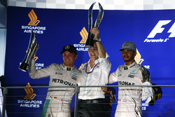 Race winner Nico Rosberg, Mercedes AMG F1 (Left) with third placed team mate Lewis Hamilton, Mercede