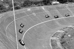Tony Brooks, Ferrari Dino 246 leads Stirling Moss, Cooper T51 Climax