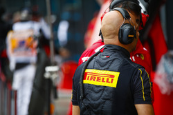 A Pirelli engineer in the pit lane